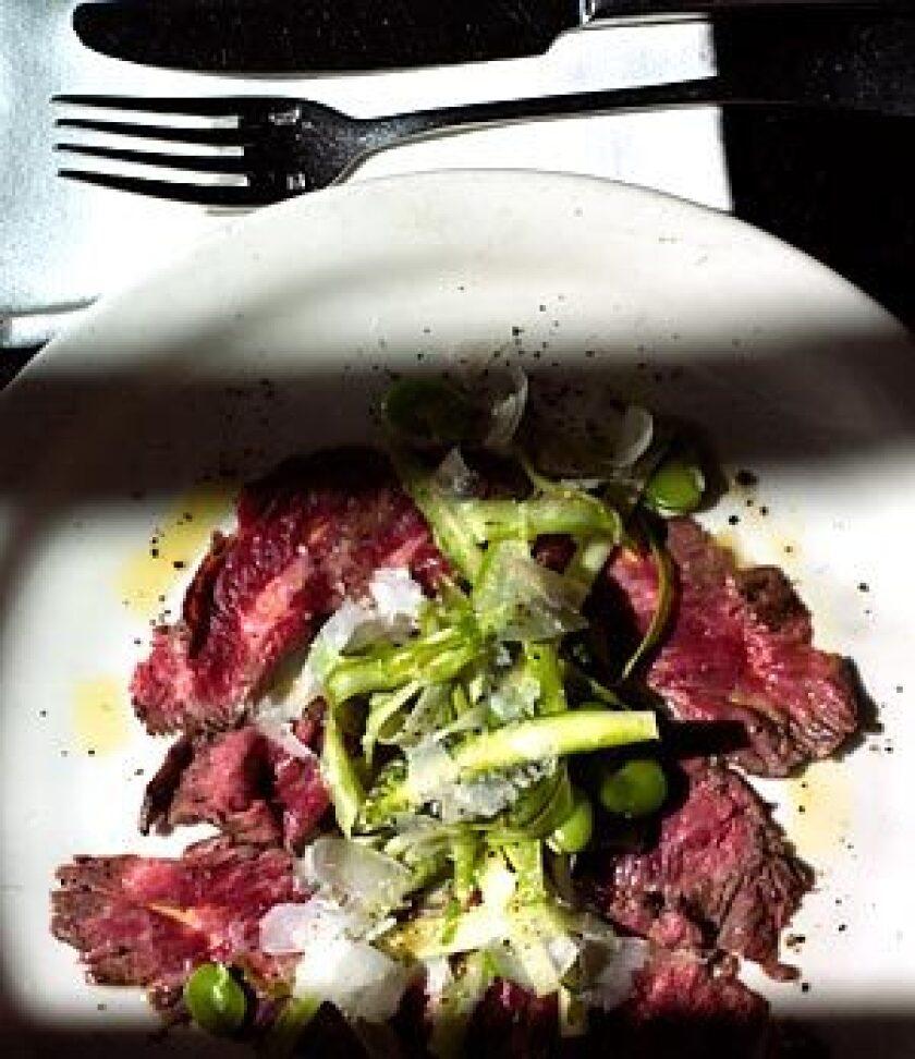 Skirt steak carpaccio with raw asparagus and fava salad