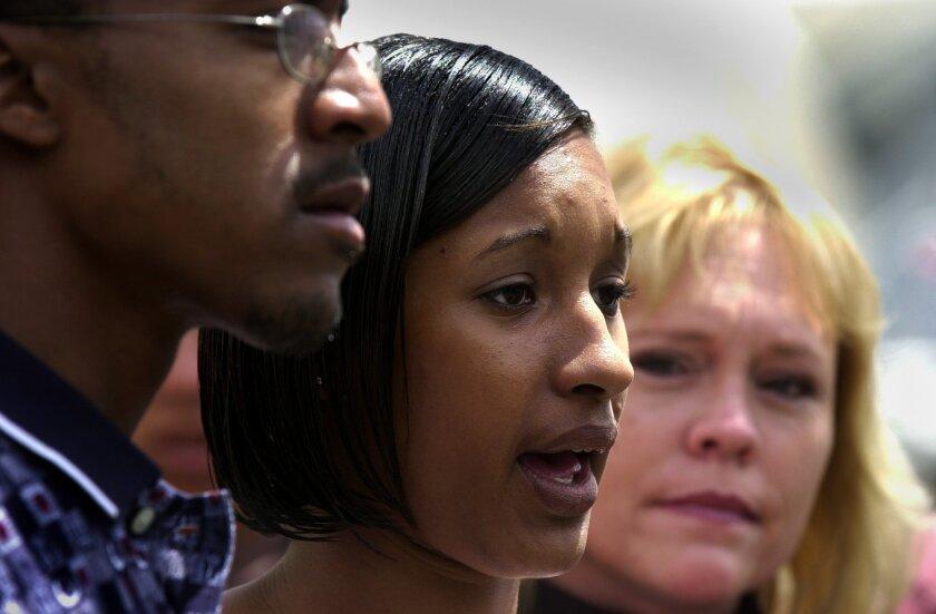 Jahi Turner's stepfather Tieray Jones, mother Tameka Jones, and Brenda van Dam at a press conference on April 30, 2002