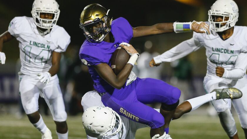 Sam Scaife hauls in a pass for St. Augustine. Scaife also caught a 28-yard touchdown pass.