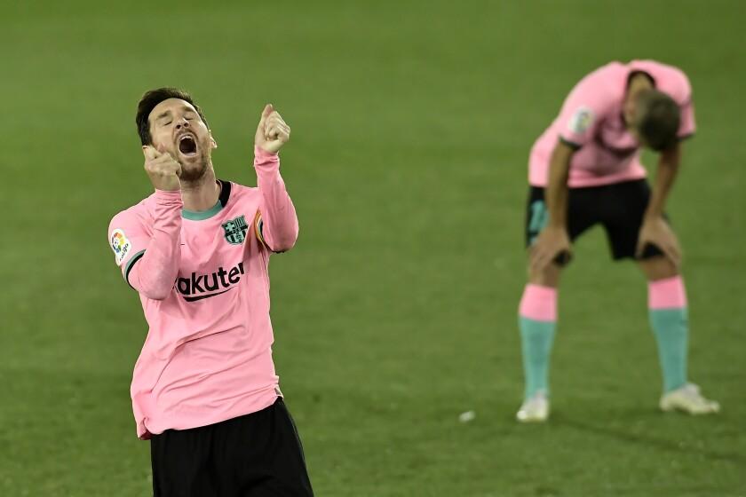 Barcelona's Lionel Messi gestures during the Spanish La Liga soccer match between Alaves and Barcelona at Mendizorroza stadium in Vitoria, Spain, Saturday, Oct. 31, 2020. (AP Photo/Alvaro Barrientos)
