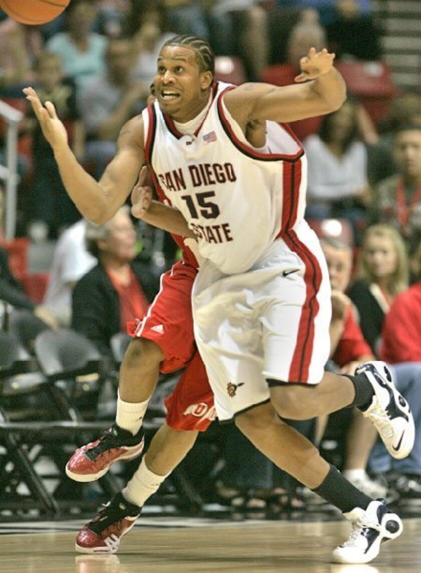 Kyle Spain and the Aztecs could stand alone in first place in the Mountain West. (John Gastaldo / Union-Tribune)