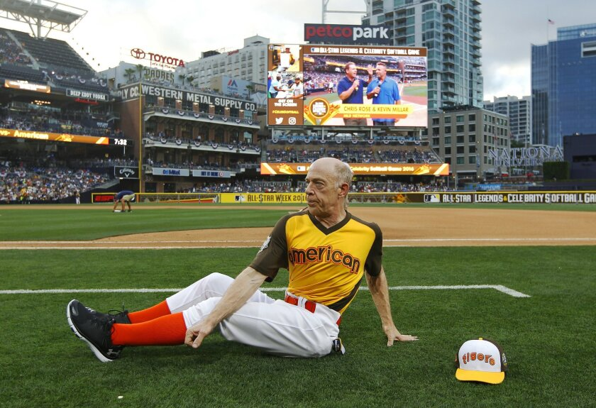 Actor J.K. Simmons stretches before playing in the Celebrity & Legend Softball Game at Petco Park.
