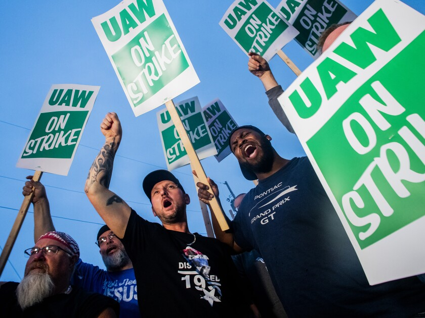 General Motors employees strike with other UAW members