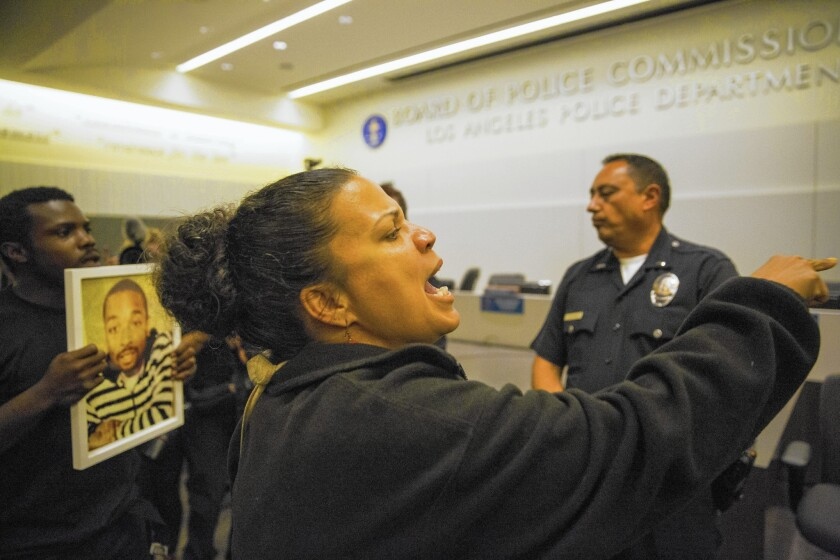 """Cal State L.A. professor Melina Abdullah joins protesters at Tuesday's L.A. Police Commission hearing at LAPD headquarters. """"It's a completely corrupt system,"""" she says of the way police shootings are investigated and handled."""