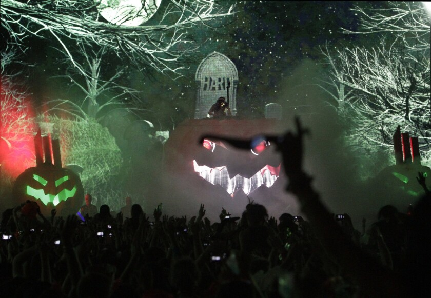 "Skrillex, on top of the Halloween pumpkin at the Hard Day of the Dead festival in 2013, has a video out for his new ""Ragga Bomb."""