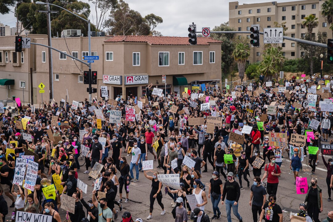 Protesters march in Hillcrest from downtown on June 6, 2020 in San Diego, California.