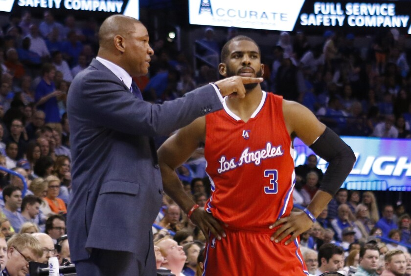Clippers Coach Doc Rivers gives instruction to point guard Chris Paul during the Clippers' 120-108 win over the Thunder.