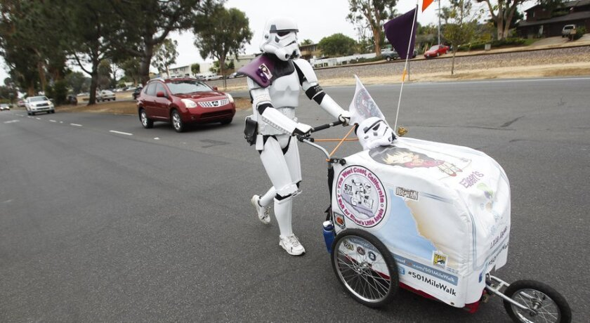 """Kevin Doyle of Minnesota walks through Leucadia on Tuesday. He has spent the past month walking more than 600 miles down the California coast in his """"Star Wars"""" Stormtrooper costume to Comic-Con in San Diego."""