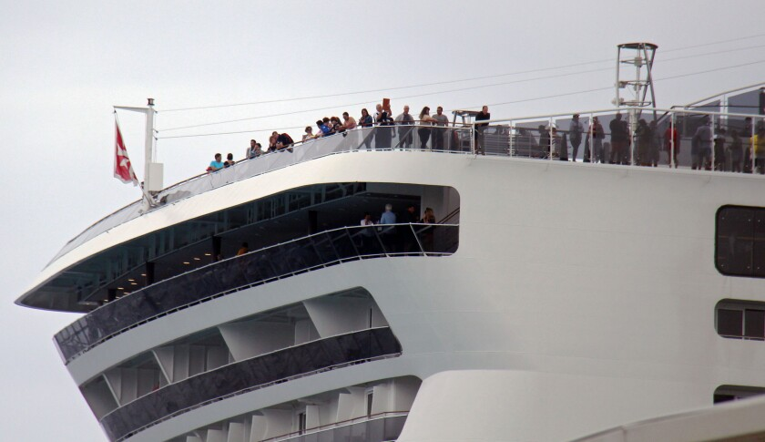 Passengers remain aboard the MSC Meraviglia cruise ship in Cozumel, Mexico, on Feb. 27, 2020.