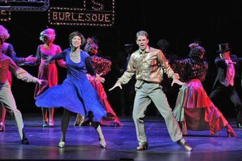 """Cassie Silva (as Peggy Sawyer) and Jeffrey Scott Parsons (as Billy Lawlor) in Moonlight Stage Productions' """"42nd Street,"""" continuing through July 26.  (Ken Jacques)"""