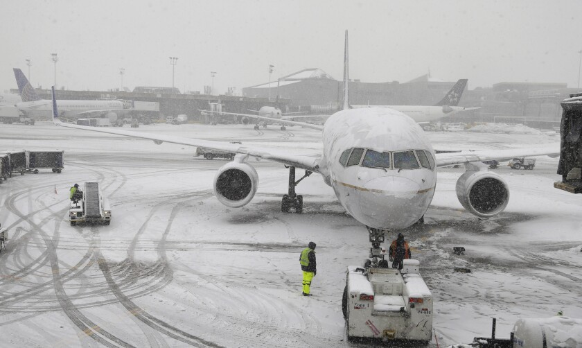 A United Airlines airplane is prepared to be pushed back from a gate on Monday at Newark Liberty International Airport in Newark, N.J. A winter storm one day after the Super Bowl canceled or delayed dozens of flights in the region.
