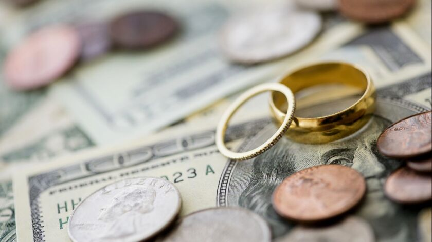 Closeup of wedding rings with money