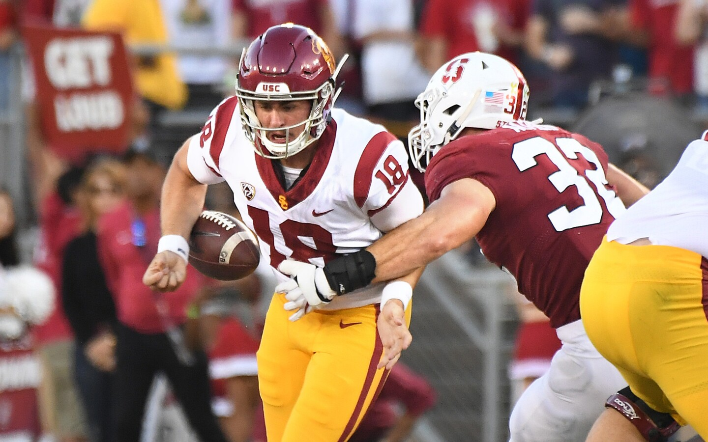 USC quarterback J.T. Daniels is stripped of the ball by Stanford linebacker Joey Alfieri on 4th down in the 2nd quarter.