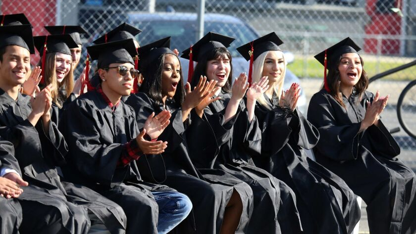 Jubilant Monterey High School graduates cheer during the Monterey High School 2019 Graduation Ceremo