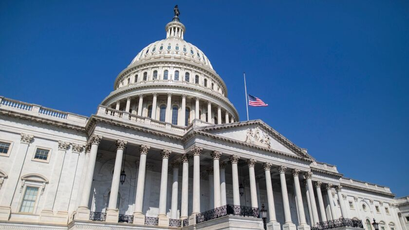The flag flies at half-staff in front of the U.S. Capitol in Washington on Sunday in honor of Sen. John McCain (R-Ariz.), who died at his home in Cornville, Ariz., Saturday at the age of 81.
