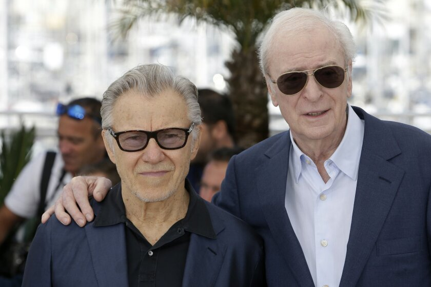 Actors Michael Caine, right, and Harvey Keitel pose for photographers during a photo call for the film Youth, at the 68th international film festival, Cannes, southern France, Wednesday, May 20, 2015. (AP Photo/Lionel Cironneau)