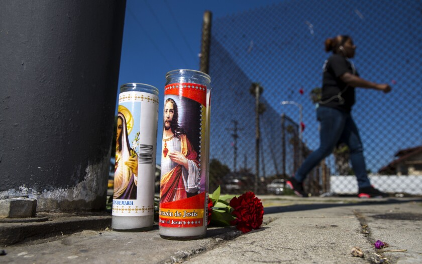 A modest memorial for a man shot and killed on Saturday sits at 81st and Hoover streets in South L.A. on Monday.
