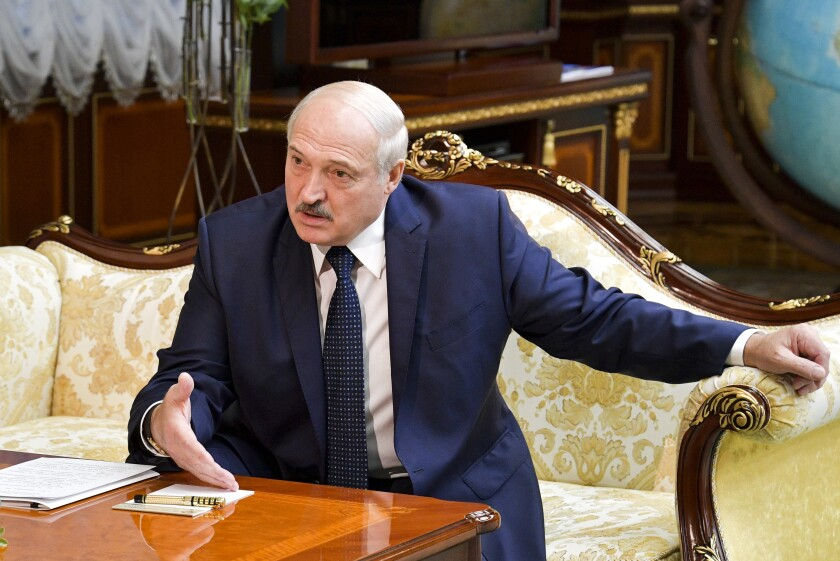 Belarusian President Alexander Lukashenko gestures while speaking to Russian Prime Minister Mikhail Mishustin, during their talks in Minsk, Belarus, Thursday, Sept. 3, 2020. On Thursday, Russia's Prime Minister Mikhail Mishustin traveled to the Belarusian capital to discuss conditions for Belarus to refinance a Russian loan. (Alexander Astafyev, Sputnik, Kremlin Pool Photo via AP)