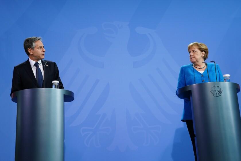 German Chancellor Angela Merkel, right, and U.S. Secretary of State Antony J. Blinken