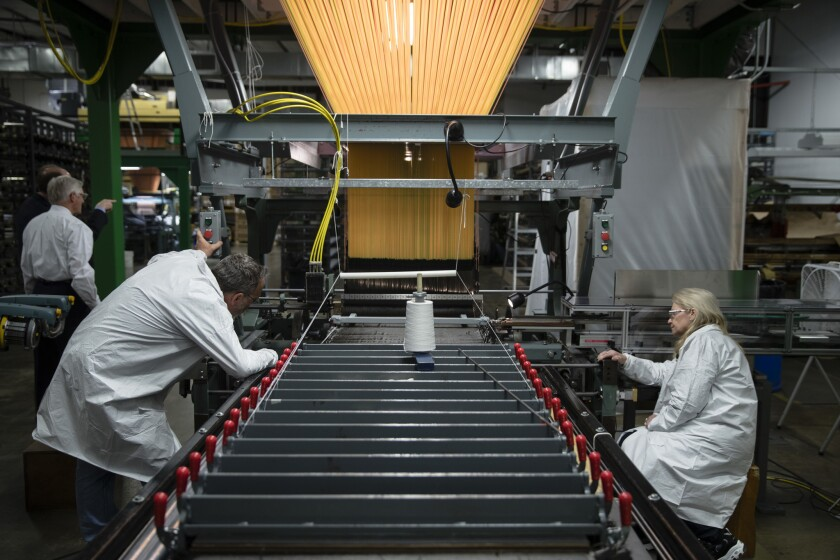 In this Thursday, March 23, 2017, file photo, workers manufacture thermal protection systems for NASA at Bally Ribbon Mills in Bally, Pa. Forecasts for U.S. economic growth are coming in slightly lower after a weak first quarter, according to a survey of business economists released Monday, June 5.