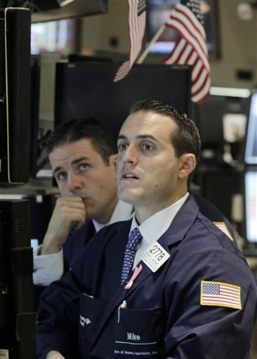 In this Oct. 7, 2010 photograph, specialists work at a post on the floor of the New York Stock Exchange Wednesday, Oct. 6, 2010. Traders are sending stock futures lower Friday, Oct. 8, as they bet the government's employment report will not show much improvement in the jobs sector. (AP Photo/Richard Drew)