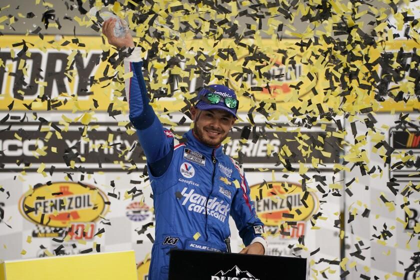 Kyle Larson celebrates after winning Sunday's NASCAR Cup race at Las Vegas Motor Speedway.