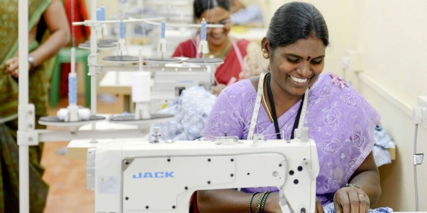 A woman makes Sudara clothing at a sewing center in India.