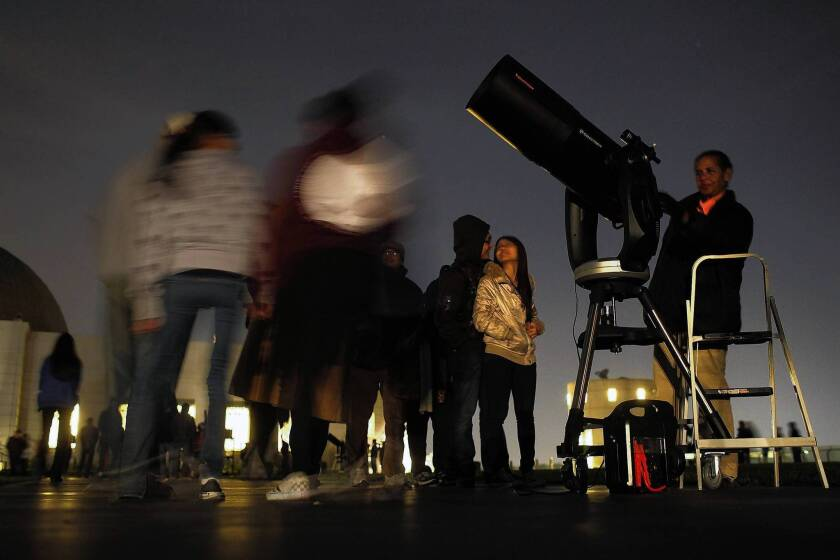Crowd gathers at Griffith Observatory to mark non-apocalypse