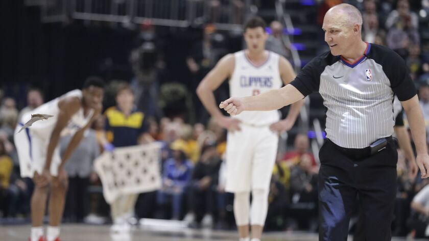 Referee Ron Garretson reacts as a bat flies around the court during a game between the Indiana Pacers and the Clippers on Feb. 7 in Indianapolis.
