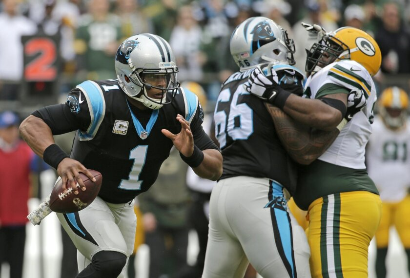 Carolina Panthers' Cam Newton (1) scrambles against the Green Bay Packers in the first half of an NFL football game in Charlotte, N.C., Sunday, Nov. 8, 2015. (AP Photo/Chuck Burton)