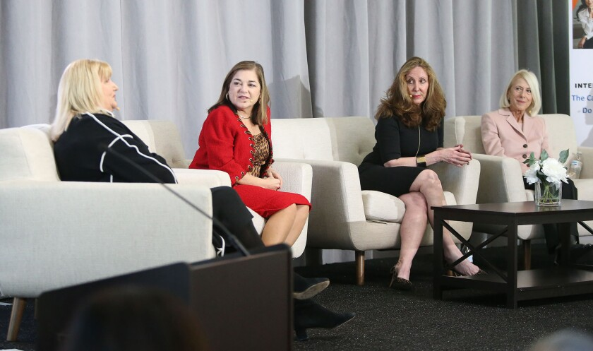 Kerry Phelan, left, president of global franchise management at Lionsgate Entertainment, answers a question from the audience Monday during the second annual Athena40 Global Conversation at UC Irvine. Other panelists are former U.S. Rep. Loretta Sanchez; Dr. Stephanie McClellan, chief medical officer at Tia; and Susan Parks, president and CEO of Orange County United Way.