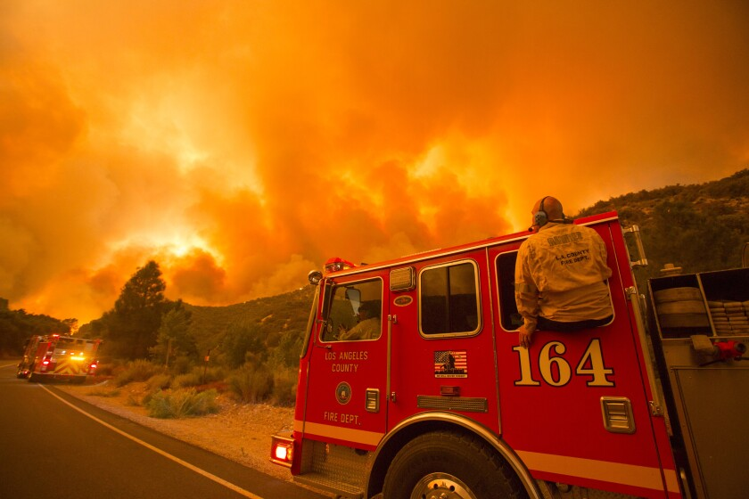Firefighters watch the Lake Hughes fire in the Angeles National Forest