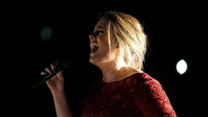 Adele performs at the 2016 Grammy Awards.