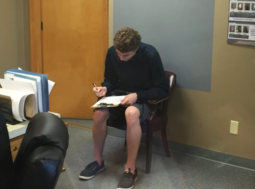 FILE--In this Sept. 6, 2016, file photo, Brock Turner registers as a sex offender at the Greene County sheriff's office in Xenia, Ohio. When the former Stanford University swimmer registered as a sex offender he joined a nationwide legion of criminals that has grown dramatically in recent years and