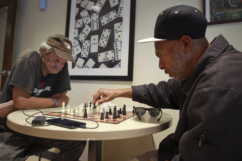 Yusuf Najeeullah, 65, right, plays Paul Piatek, 70, in a game of chess while in the game room at the Gary and Mary West Senior Wellness Center on Tuesday, October 15, 2019 in San Diego, California.