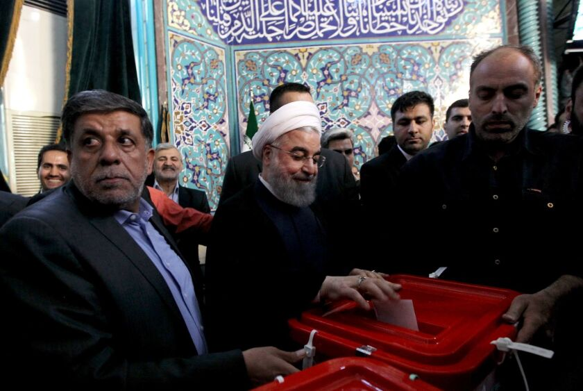 Hassan Rouhani casts his ballot