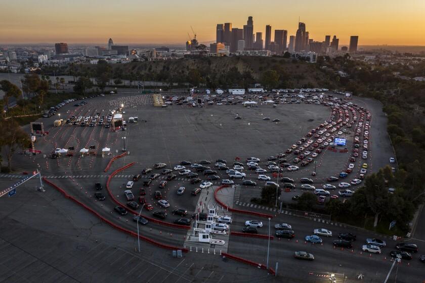 Cars line up for COVID-19 testing at Dodger Stadium on Nov. 11.