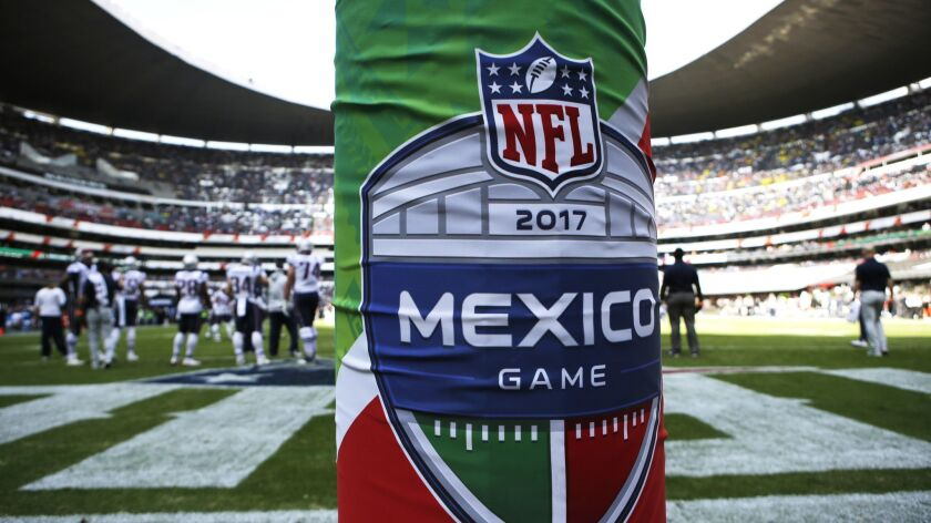 The logo for the NFL's Mexico Game is displayed on a goal post pad during warmups before an NFL foot