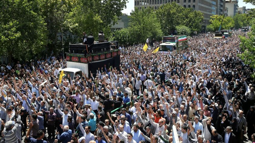 Iranians on Friday fill the streets of Tehran for a funeral for victims of Wednesday's Islamic State militant attacks.