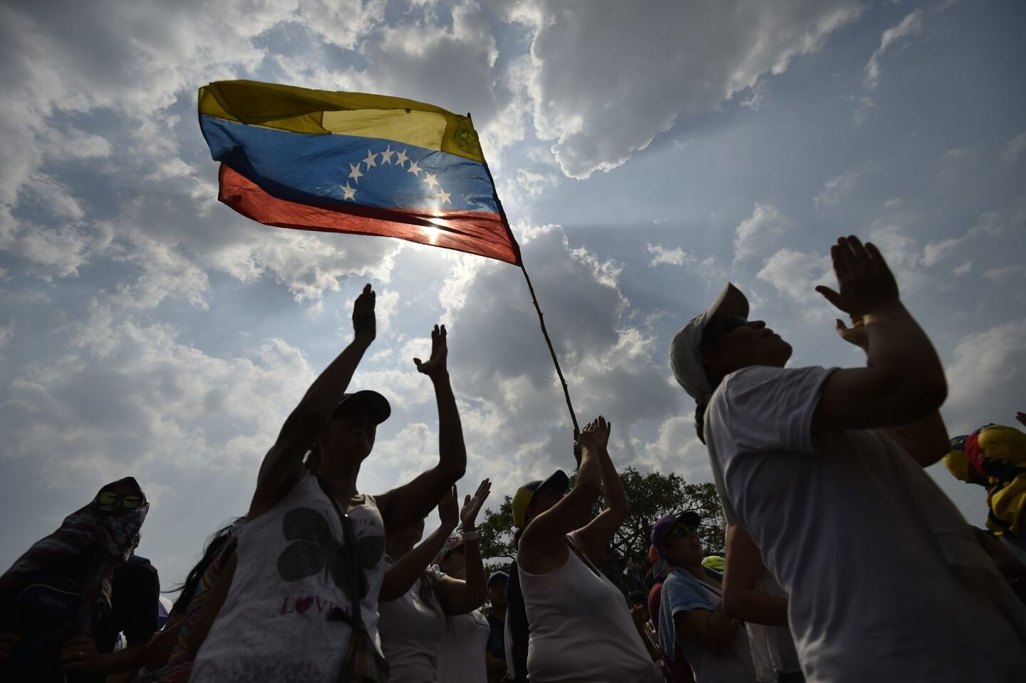 "People attend ""Venezuela Aid Live"" concert, organized to raise money for the Venezuelan relief effort at Tienditas International Bridge in Cucuta, Colombia, on February 22, 2019. - Venezuela's political tug-of-war morphs into a battle of the bands on Friday, with dueling government and opposition pop concerts ahead of a weekend showdown over the entry of badly needed food and medical aid. (Photo by Luis ROBAYO / AFP)LUIS ROBAYO/AFP/Getty Images ** OUTS - ELSENT, FPG, CM - OUTS * NM, PH, VA if sourced by CT, LA or MoD **"