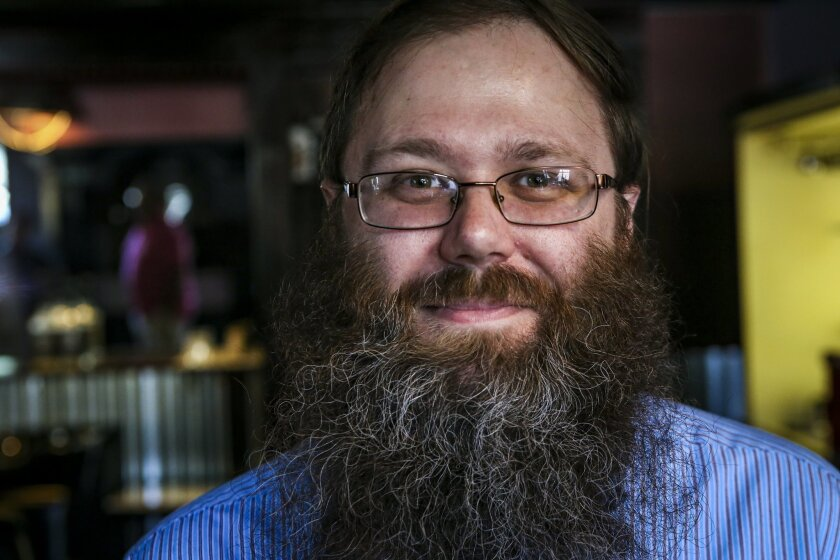 Journal Star Political Reporter Chris Kaergard poses for a photo before having his beard trimmed at Menzoil Men's Grooming Station & Barbershop in East Peoria, Ill., Saturday, July 9, 2016. Satisfied by the stopgap budget reached through compromise and bipartisanship in the capital, Kaergard decide