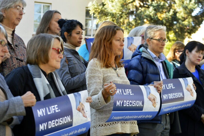 Right-to-die advocates rally in Santa Fe, N.M., in 2015. California's assisted suicide law took effe
