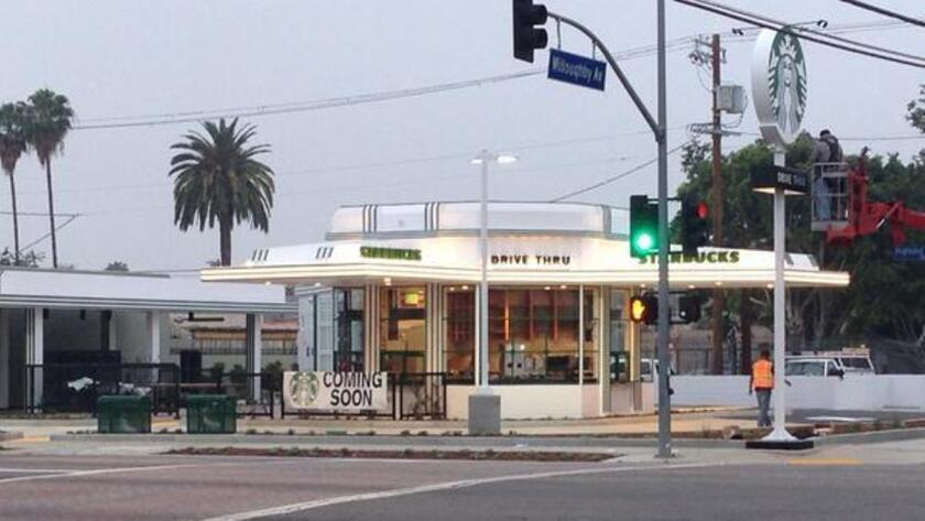 The renovated gas/caffeine station at Highland and Willoughby is now a Starbucks.
