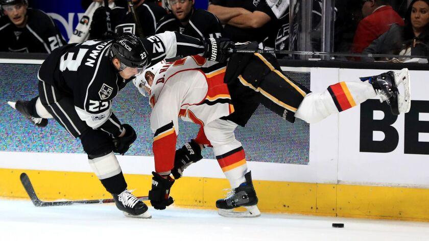 LOS ANGELES, CA - APRIL 06: Dustin Brown #23 of the Los Angeles Kings checks Dougie Hamilton #27 of