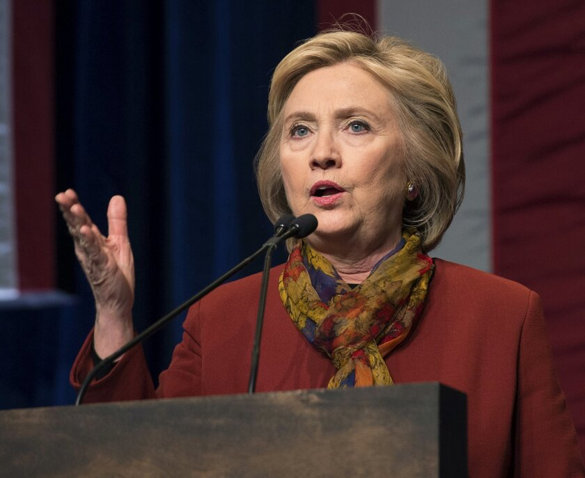 """FILE - In this Feb. 16, 2016 file photo, Democratic presidential candidate Hillary Clinton speaks in New York. A federal judge could allow a conservative legal group to question top aides to former Secretary of State Hillary Clinton about whether she deliberately sought to subvert open records laws by using a private email server. U.S. District Court Judge Emmet G. Sullivan ruled Feb. 23 that Judicial Watch can prepare a plan for """"narrowly tailored discovery"""" into the circumstances surrounding the Democratic presidential candidate's use of a home-based email server during her four-year stint as the nation's top diplomat. (AP Photo/Bryan R. Smith, File)"""