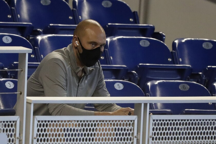 Marlins CEO Derek Jeter watches the team practice July 14 in Miami.