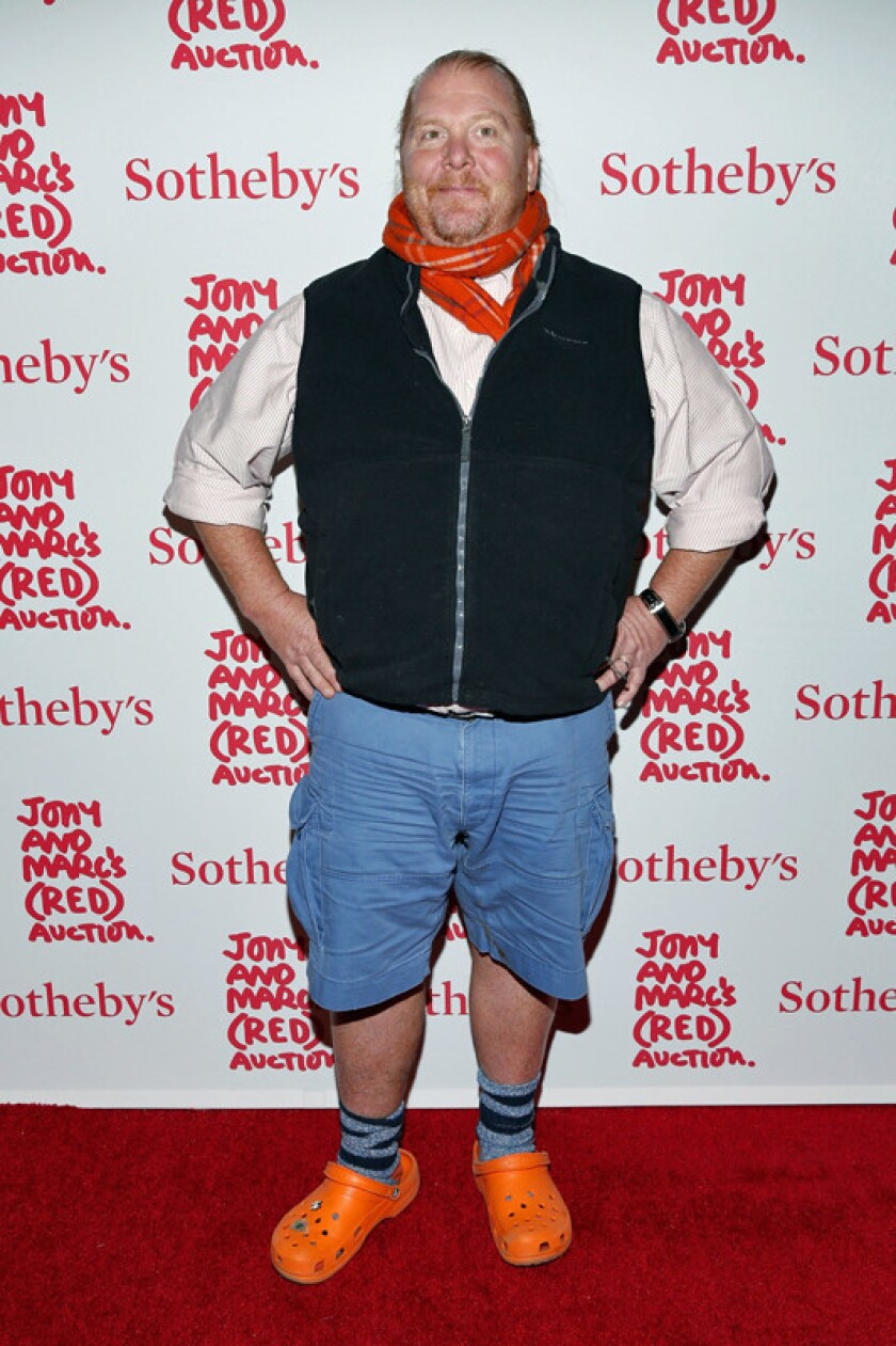 Chef Mario Batali, wearing his trademark orange Crocs, attends Jony and Marc's (RED) Auction at Sotheby's on Saturday in New York City.
