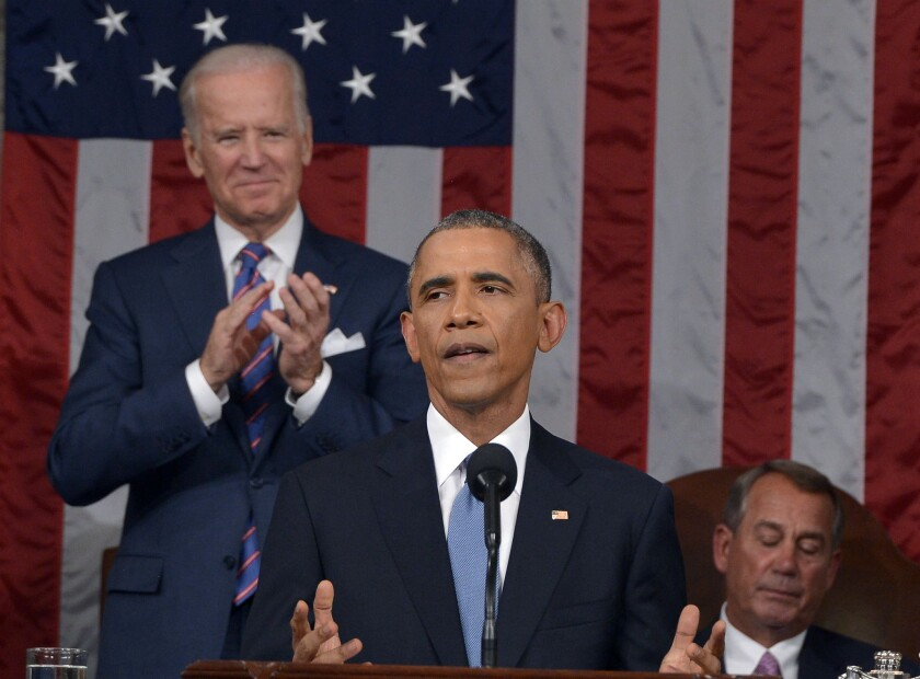 President Obama delivers the State of the Union address. Joining him behind the podium are Vice President Joe Biden, left, and House Speaker John Boehner (R-Ohio).