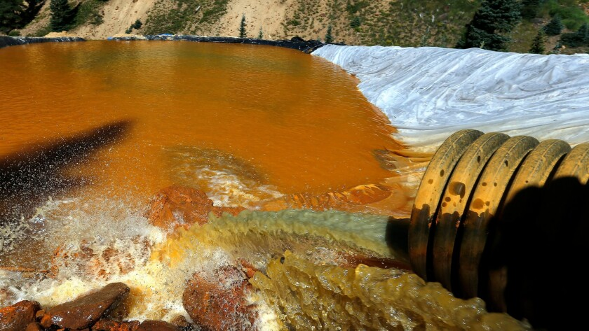 Orange-colored water in a retention pools built to contain the contaminated water that exploded from the Gold King Mine in 2015.