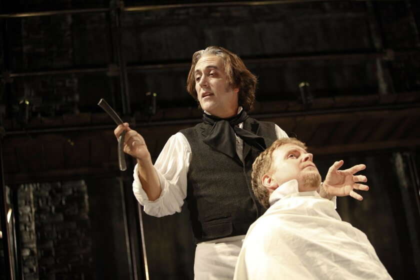 "Sean Murray (left) directs and takes the starring role in ""Sweeney Todd. The unlucky gent in the chair is Steve Gunderson as Judge Turpin."